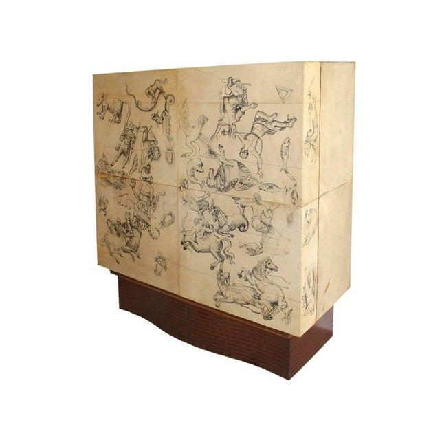 Franco Albini Cabinet bar Walnut, parchment Made for Daghia Italy, circa 1940. Zodiac symbols are represented on the...