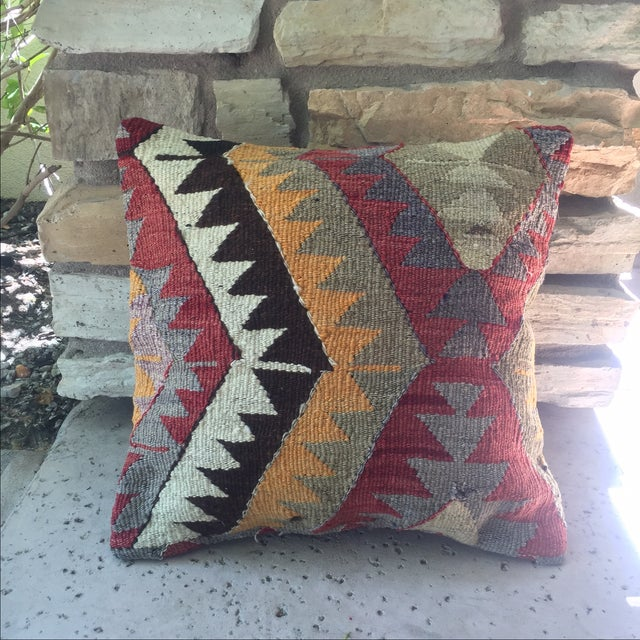 This is a lovely vintage Turkish kilim pillow cover, featuring a geometric pattern. The back is made with new canvas...