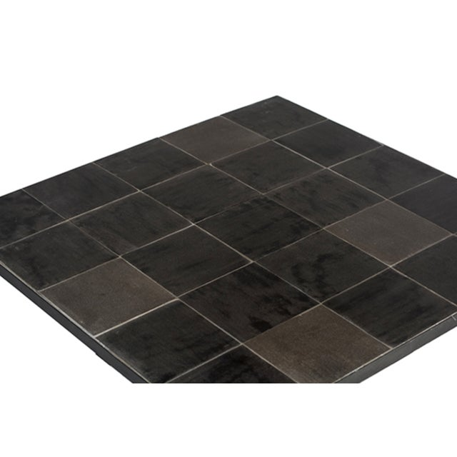 Beautiful modern square coffee table with powder coated black iron base and lava stone tile inset top. Great for use...