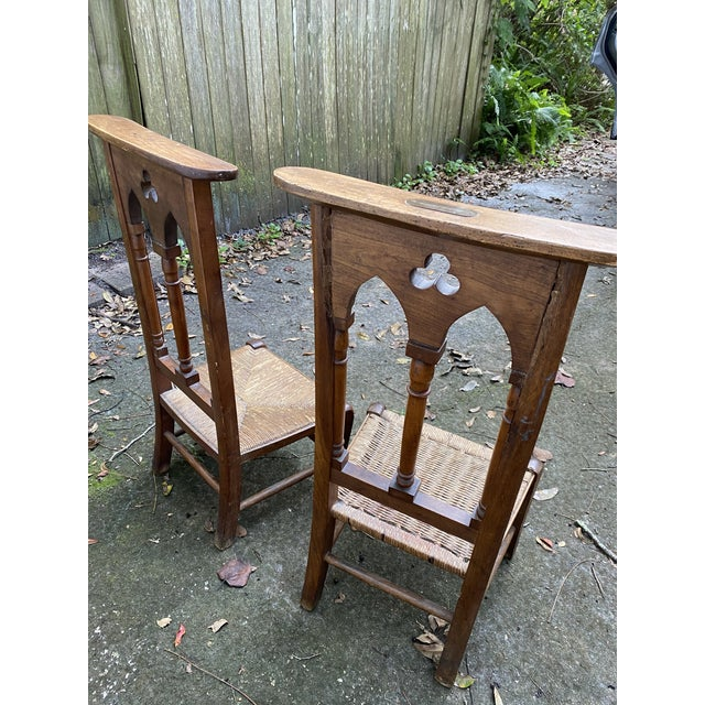 Pair of old, antique prayer chairs. Also called a Prie-Dieu or a Kneeler. Feature rushed seats. They are not exact...