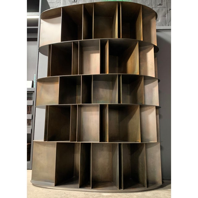 Sculptural acid-etched iron bookcase made in Italy by DeCastelli.