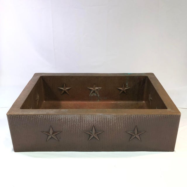 """Hammered Copper 33"""" Star Apron Sink This stunning apron-style kitchen sink is constructed of hammered copper. It features..."""