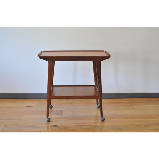Gorgeous small mid century style bar or tea cart/trolley. Solid Teak. Good condition. Small watermark shown in detail...