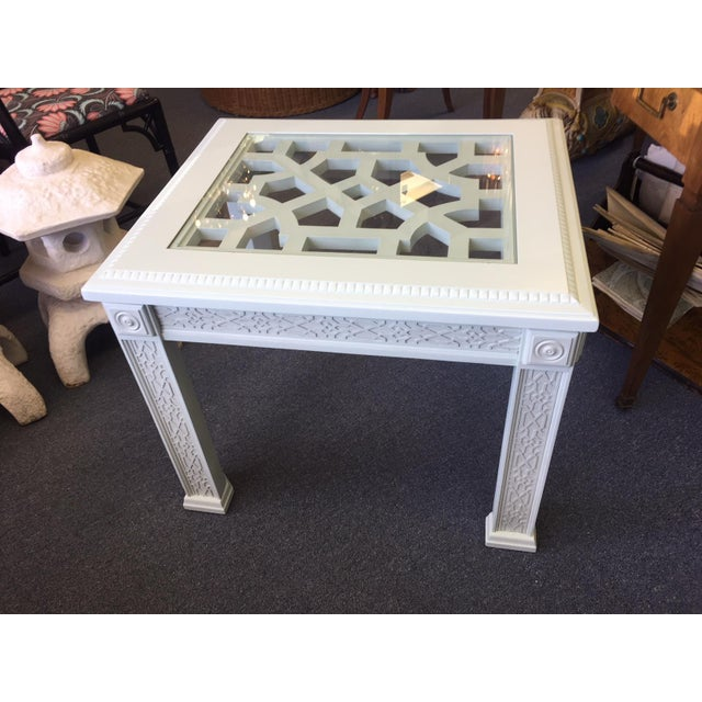 This is a beautiful Palladian blue side table with fretwork and a glass overlay flush. The piece also features a...