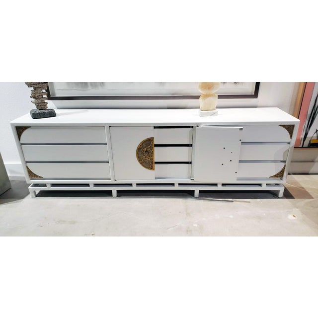 A beautiful 1960s handcrafted and very large white lacquered console/credenza cabinet with 3 drawers on each side of the...