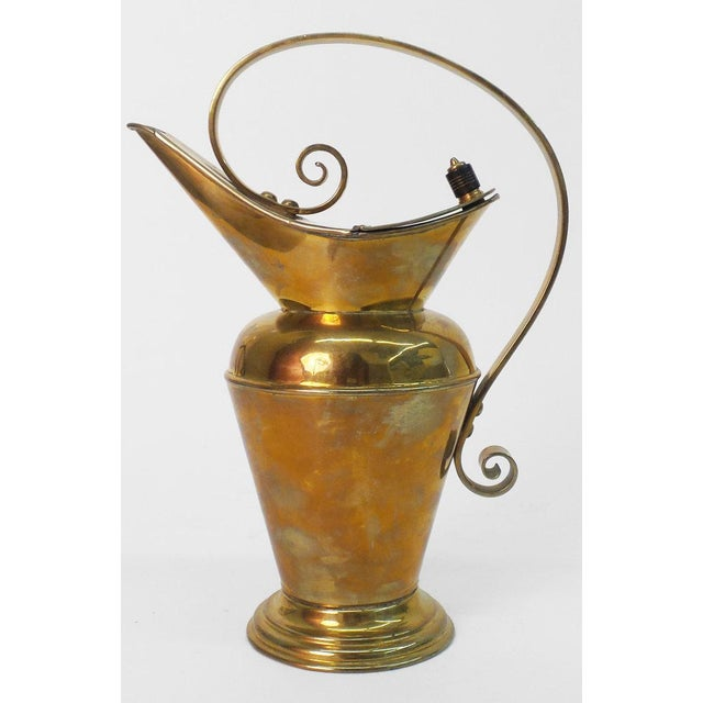 """A remarkable brass water jug having an ebony knob and made by Benham and Froud; design by Christopher Dresser. See """"C...."""