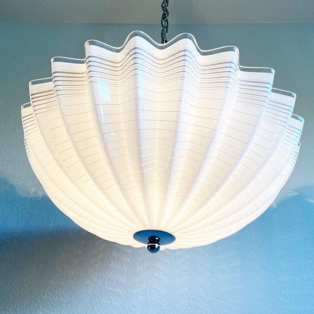Pleats please! Large mid-century modern Lucite pendant chandelier featuring a pleated and striped umbrella-style shade...