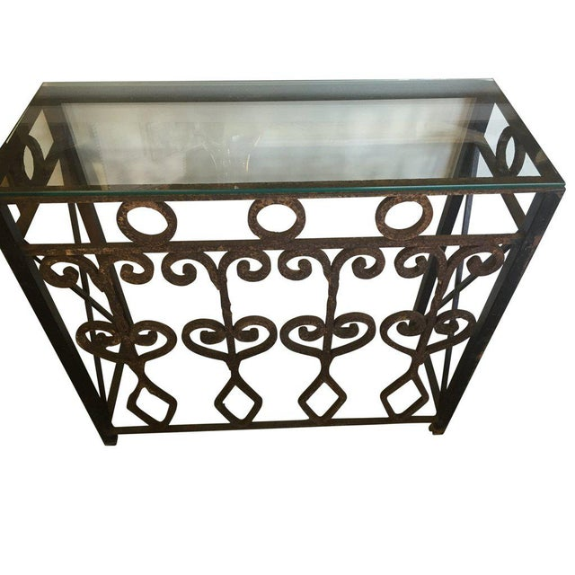 This rustic but elegant indoor outdoor console table is hand forged vintage iron. It comes with a glass top. Any top can...