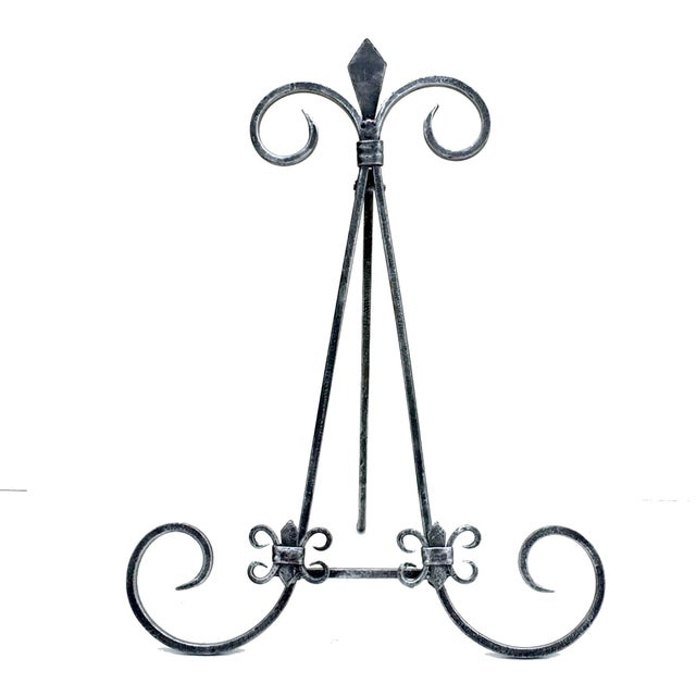 """Two display easels in black distressed iron finish. Each measures 14.5"""" x 11.5"""" x 10"""". Easels fold approximately flat...."""