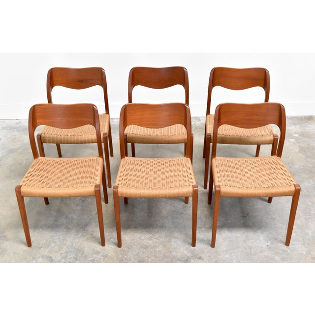 Timeless set of six Danish modern teak & rope cord dining chairs by Niels Moller for J.L Moller, C1960s. The sleek,...