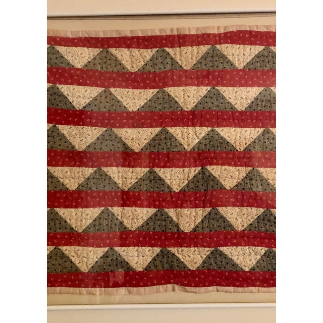 Early 20th century doll quilt. Framed in a simple white metal frame. Very graphic as contemporary art or charming as an...