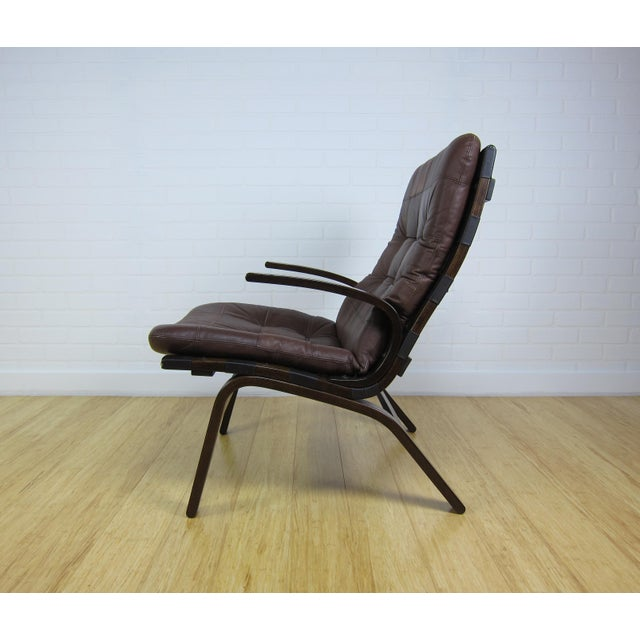 Stained bentwood frame Scandinavian leather lounge chair in the style of Westnofa and Farstrup. Very comfortable. Frame...