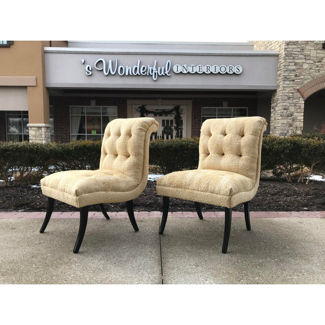 Beautiful pair of arm less accent chairs that have been restored in a Champagne color animal cut velvet textile. Chairs...
