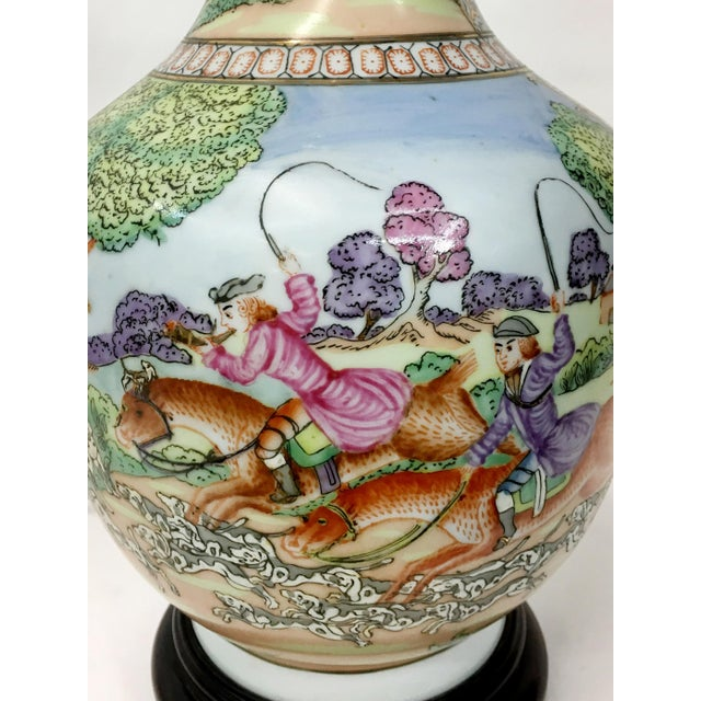 Vintage style porcelain rectangular flask shape vase with under glaze and outside decoration depicting hunters in forest....