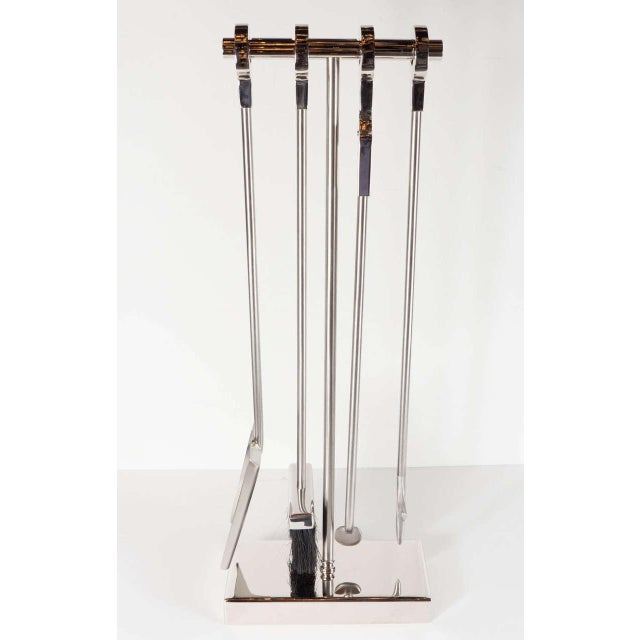 This exceptional custom four-piece fire tool set consists of a stoker, shovel, brush and log holder. They are neatly...