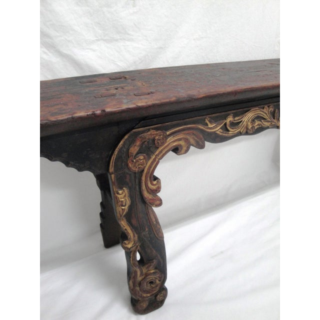 A 19th century painted bench. The unique hand carved detail on this bench begs you to sit for a spell! It is perfect for...