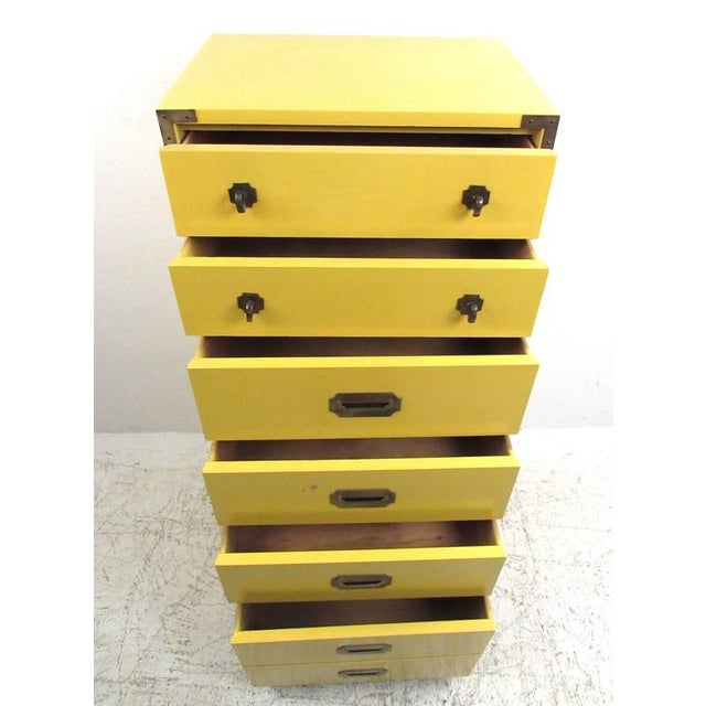 Stylish campaign style lingerie chest features unique yellow lacquered finish and campaign style brass trim. Ideal storage...