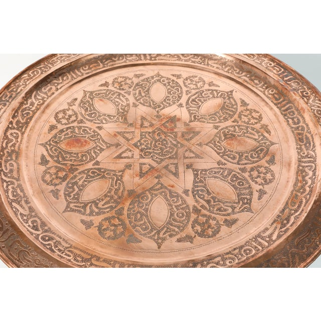 Handcrafted Moroccan round copper tray table on iron base. Moroccan round brass tray table on iron folding base. Nice...