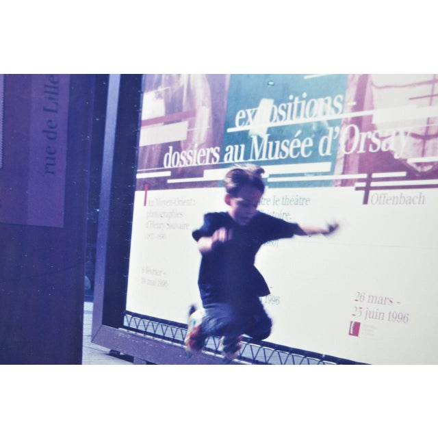 Color Photograph of Child Jumping in Front of French Museum Poster For Sale - Image 4 of 5