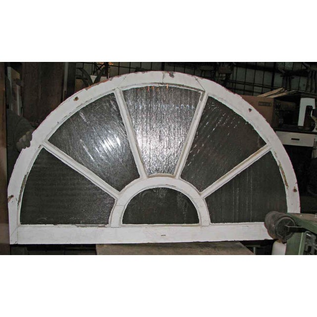 This fan light transom window is from a 19th century New England church. The frame is solid oak and the rippled and ridged...