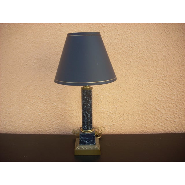 Faux, blue marble table lamp with brass colored base. A perfect lamp for a vanity or in a powder room with classic design....