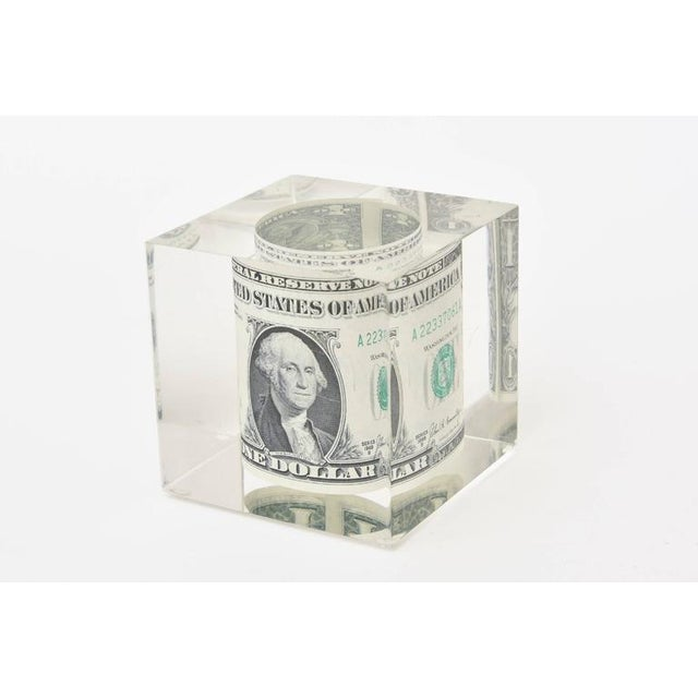 This fun and vintage rolled dollar bill is encased and floating in Lucite. A great desk accessory sculpture or a...