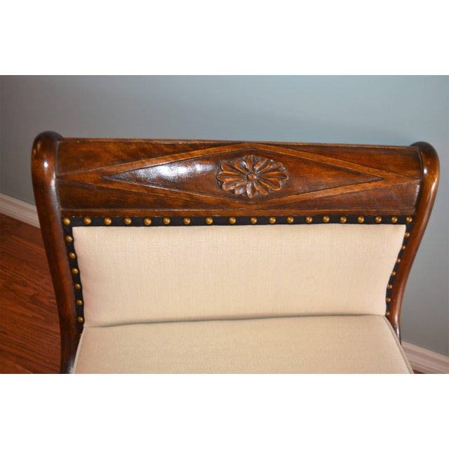 A very elegant Empire style chaise in solid mahogany with hand-carved swan motif at each end of the chaise. The chaise has...