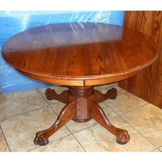 20th Century Gothic Round Oak Claw Foot Pedestal Dining Table With Extra Leaf Preview