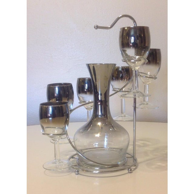 Unwind with this 1960s Silver Spiral ombre decanter set! Set includes silver rack, six wine goblets, and decanter....