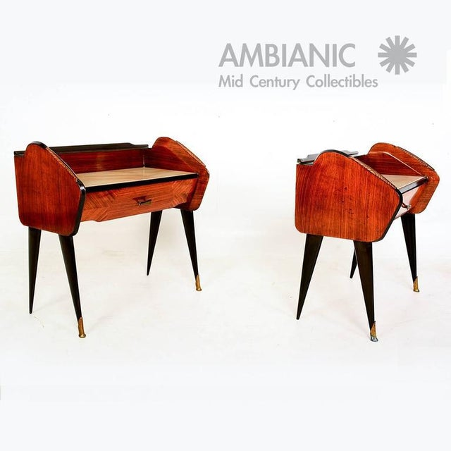 For your consideration an amazing pair of bedside table with sculptural legs and details. Bronze feet and original glass top.