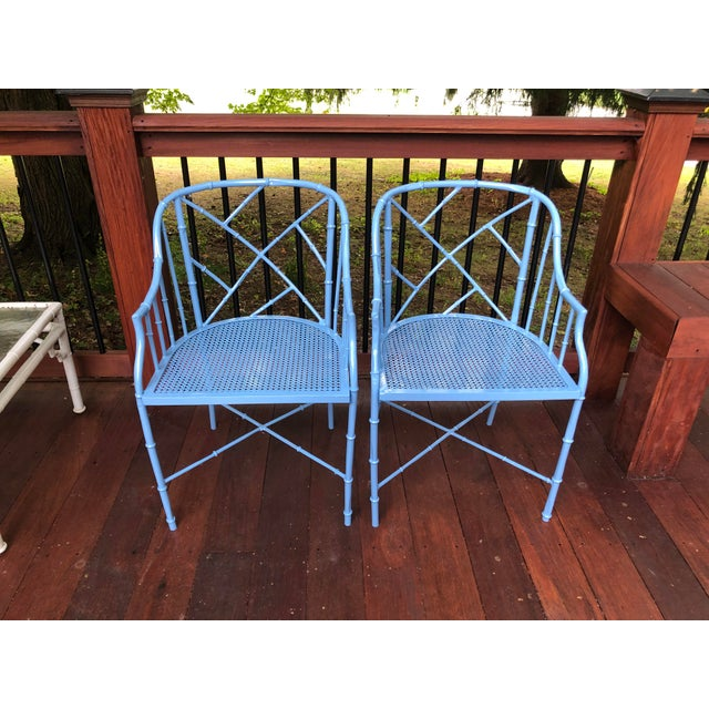 A pair of cast aluminum faux bamboo barrel chairs. Freshly professionally powder coated.