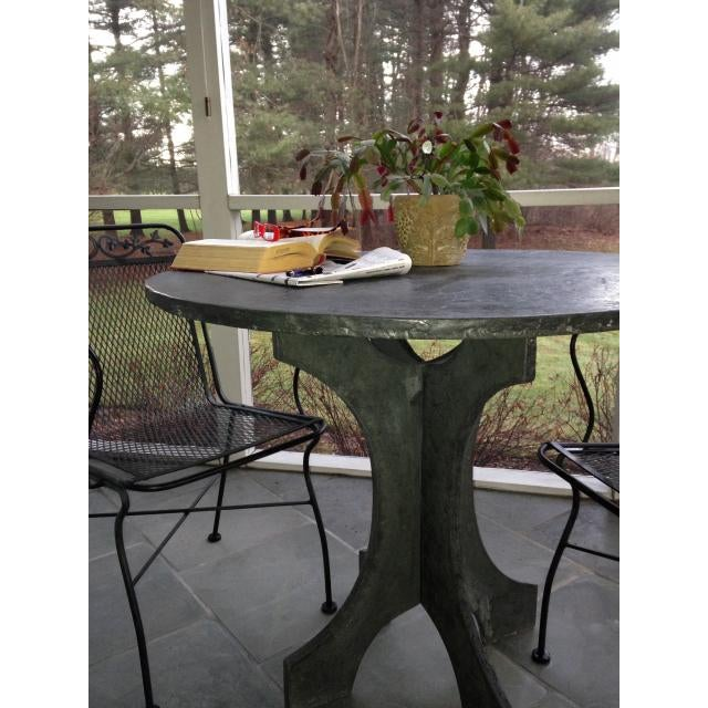 "The concrete ""slate"" look bistro table is cast in three pieces. The legs interlock...one slipping over the other. The..."
