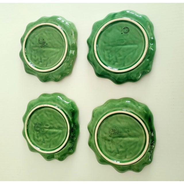 Four fun ceramic lettuce-ware salad plates by Bordallo Pinheiro.