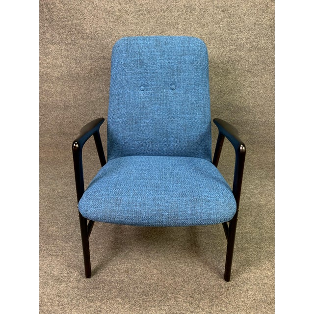 Here is a sculptural 1960's easy chair designed by Alf Svensson and manufactured in Sweden by Dux. This fully restored and...