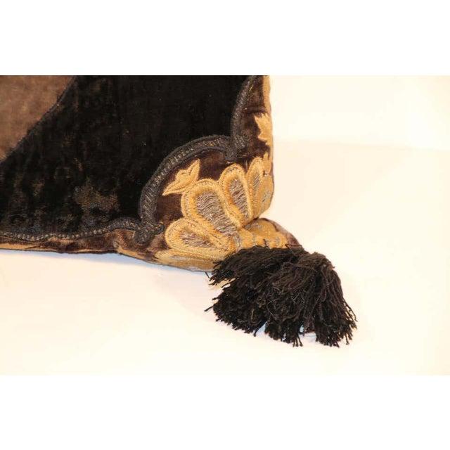 Baroque silk decorative accent pillow with black tassels. Black silk velvet applique with large black tassels on each...