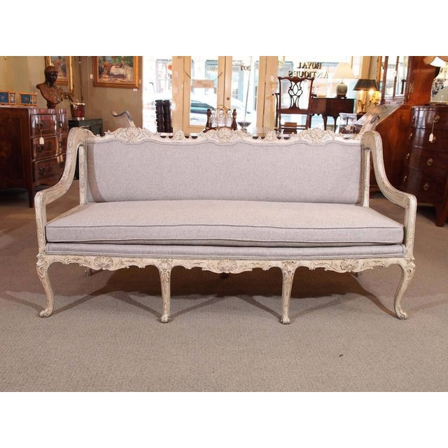 Antique French Rococo grissaile sofa.