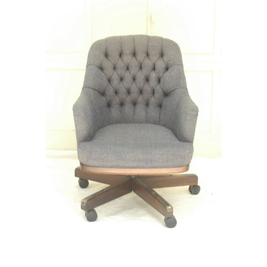 Chesterfield-Esque Tufted Wool Swivel Chair. It's in great condition with some age on its base. The color of the fabric is...