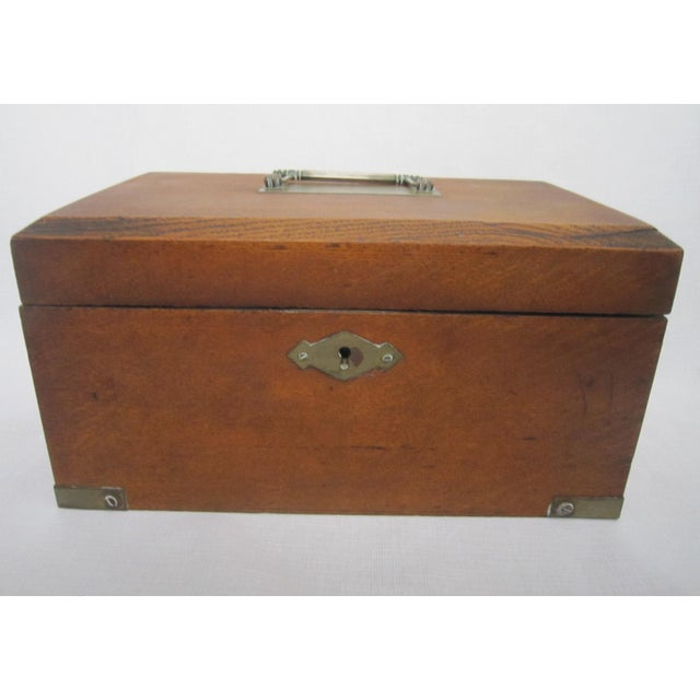 Old walnut Humidor with metal tray on the inside. Simple, elegant design with brass fittings.