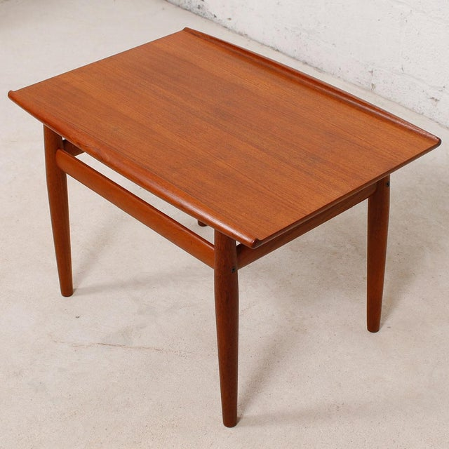 A wonderful Danish Modern accent table by Grete Jalk. The raised lip edges are characteristic of Jalk's designs. What a...