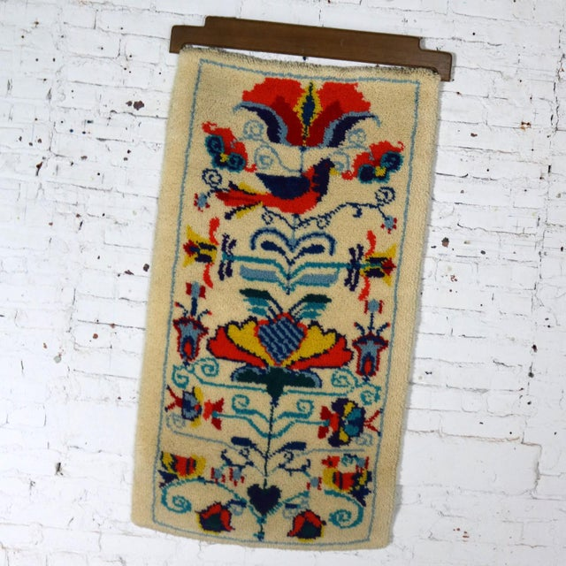 Handsome traditional motif Scandinavian vintage mid-century hooked rug wall hanging with wood hanging bracket. It is in...