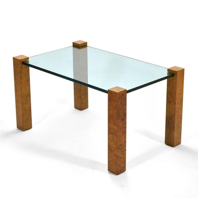 This striking design by Probber has a great minimalist aesthetic. Four legs of burled wood set in the corners like a...