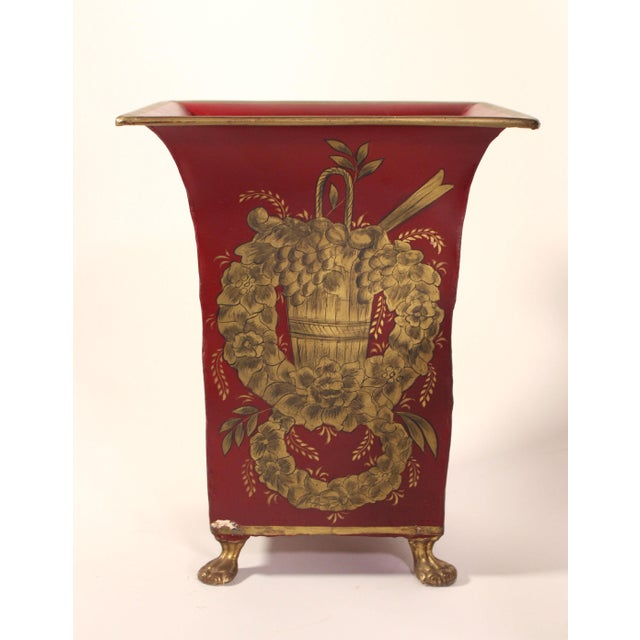 Intricately painted in gold and red with black details, this brass lion-footed tole cachepot can serve many purposes and...