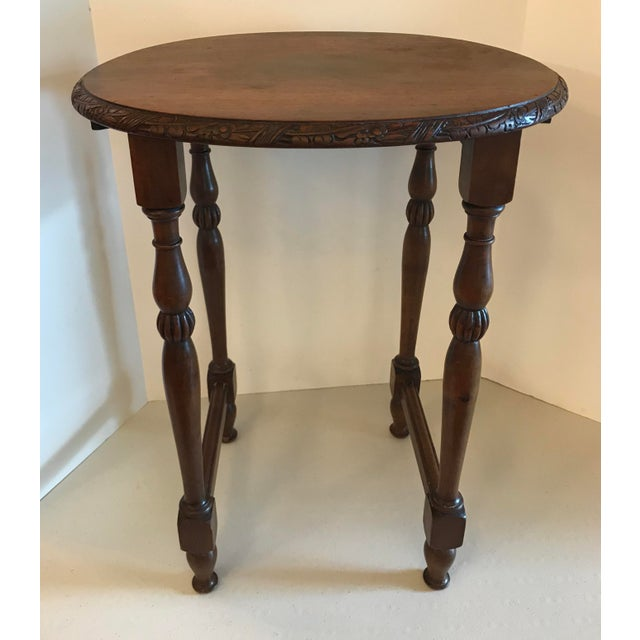 Pretty little carved top French drink or wine table. Love the carved accents on the top edge and the legs! Nice!