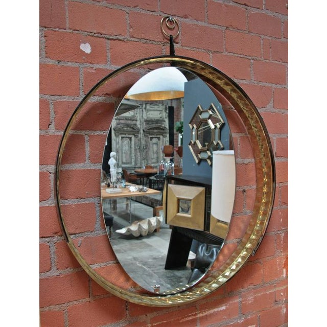 Italian mirror with wood and brass frame.