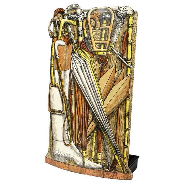 Piero Fornasetti, umbrella stand decorated with a trompe l'oeil tecnique. Original label. 1960 ca. Still has the wooden...
