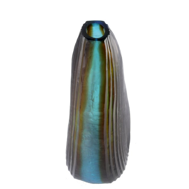 Tall cut glass vase made by Oggetti in Italy.