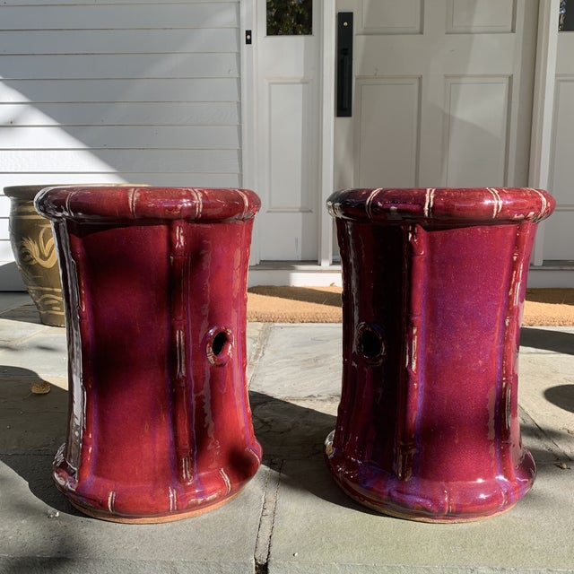 Iridescent ox blood (almost Magenta) Bamboo design Garden Stools. Very substantial and sturdy. Glaze has an iridescent...