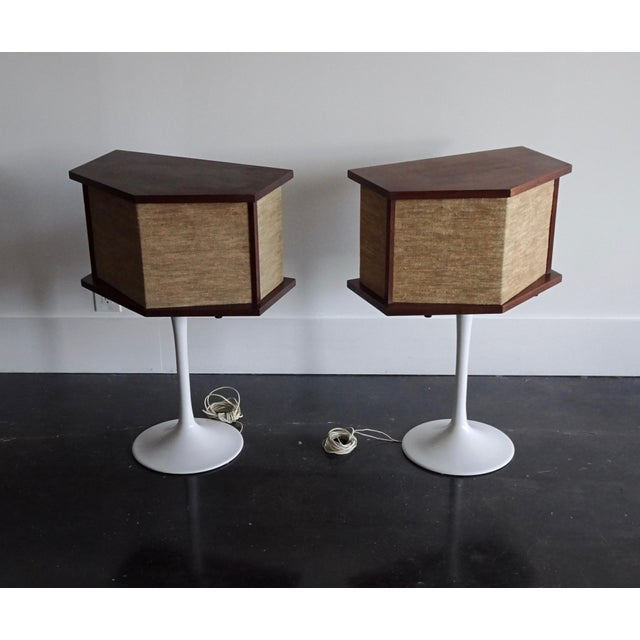 Pair of vintage Bose speakers from the 70's. Mounted on Saarinen style white tulip pedestal bases. Bases have been...