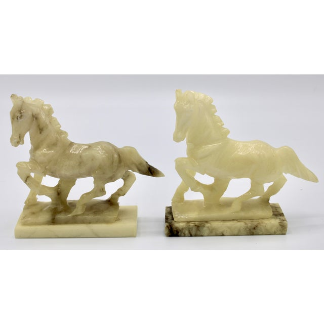 A stunning pair of Mid-20th Century Italian Alabaster Stallions. These would look superb on a fireplace mantle, or as...