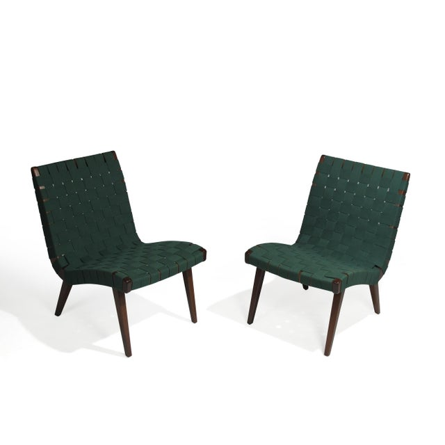 Pair of armless lounge chairs designed by Jens Risom for Knoll. Frames of solid maple with an ebonized walnut finish and...